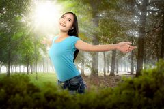 Beautiful asian woman enjoying summer time after spring Royalty Free Stock Photo