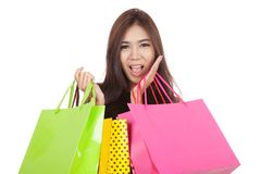 Beautiful Asian woman  excited with  shopping bags in both hands Royalty Free Stock Image