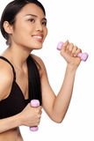 Beautiful Asian woman exercising with dumbbells Stock Images