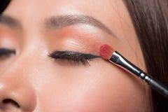 Beautiful asian woman face with perfect makeup applying blusher. Beautiful asian woman face with perfect makeup applying blusher Royalty Free Stock Photo