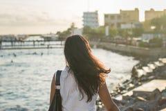 Beautiful asian woman facing public beach. At Maldives Royalty Free Stock Images