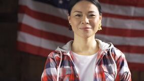 Smiling Asian Woman Proudly Posing On Striped America`s Flag Back