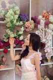 Beautiful asian woman florist in pink dress in flower store Royalty Free Stock Photos