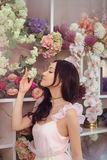 Beautiful asian woman florist in pink dress in flower store Royalty Free Stock Photography
