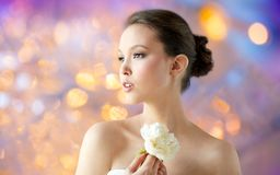 Beautiful asian woman with flower Royalty Free Stock Images