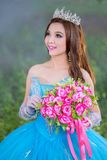 Beautiful Asian woman flower bouquet on hand with traditional dr royalty free stock photos