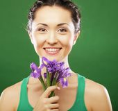Beautiful asian woman with flower iris Royalty Free Stock Photos