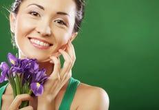 Beautiful asian woman with flower iris Stock Image