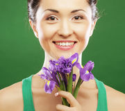 Beautiful asian woman with flower iris Stock Image