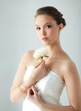 Beautiful asian woman with flower and jewelry Stock Images