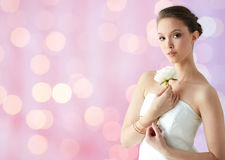 Beautiful asian woman with flower and jewelry Royalty Free Stock Photos