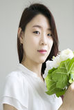 Beautiful asian woman with flowers Royalty Free Stock Image