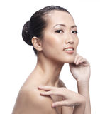Beautiful Asian woman gently touching her face. Stock Photo