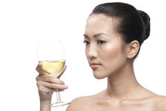Beautiful Asian Woman with glass white wine Stock Image