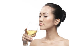 Beautiful Asian Woman with glass white wine Royalty Free Stock Images