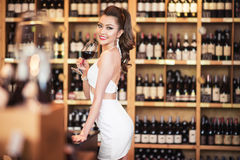 Beautiful asian woman with a glass of wine Royalty Free Stock Photo