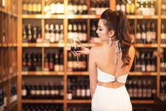 Beautiful asian woman with a glass of wine Stock Image