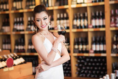 Beautiful asian woman with a glass of wine Royalty Free Stock Images