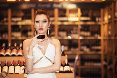 Beautiful asian woman with a glass of wine Stock Photos
