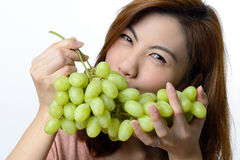 Beautiful asian woman with grape Royalty Free Stock Photography