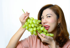 Beautiful asian woman with grape Royalty Free Stock Images