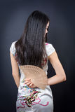 Beautiful Asian woman with a hand fan Royalty Free Stock Photography