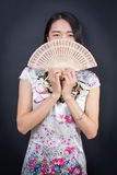 Beautiful Asian woman with a hand fan Royalty Free Stock Images