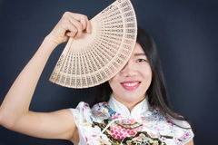 Beautiful Asian woman with a hand fan Stock Image