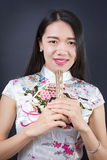 Beautiful Asian woman with a hand fan Royalty Free Stock Image