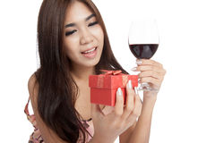 Beautiful Asian woman happy with gift box and red wine Royalty Free Stock Image