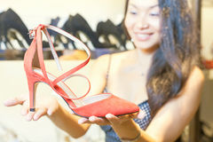 Beautiful asian woman happy to receive gift shoes as a present Royalty Free Stock Images