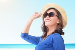 Beautiful asian woman with hat on summer vacation royalty free stock images
