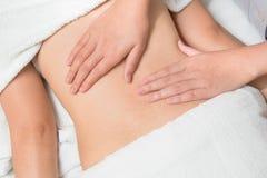 Beautiful asian woman having deep massage Stock Image