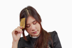 Beautiful Asian woman hold credit cards, thinking. Beautiful Asian woman hold credit cards, thinking,  on white background Stock Photography