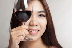 Beautiful Asian woman hold glass of red wine Stock Images
