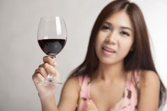 Beautiful Asian woman hold glass of  red wine Stock Photo