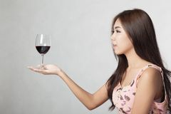 Beautiful Asian woman hold glass of red wine on her palm hand Stock Photography