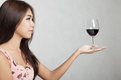 Beautiful Asian woman hold glass of red wine on her palm hand Stock Photos
