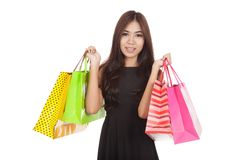 Beautiful Asian woman  hold shopping bags in both hands Royalty Free Stock Photo