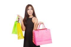 Beautiful Asian woman hold shopping bags look away Stock Photography
