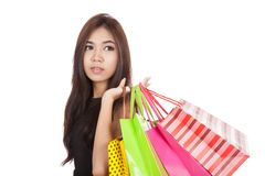 Beautiful Asian woman hold shopping bags look away Stock Images