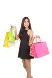 Beautiful Asian woman hold shopping bags look away Stock Photo
