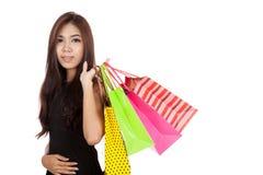 Beautiful Asian woman hold shopping bags look at camera Stock Image
