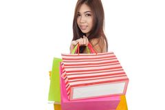 Beautiful Asian woman hold shopping bags look at camera Stock Images