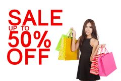 Beautiful Asian woman hold shopping bags with sale 50% sign Stock Photo