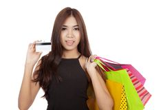 Beautiful Asian woman hold shopping bags show a cradit card Stock Photos