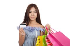 Beautiful Asian woman hold shopping bags show a credit card Stock Photo