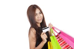 Beautiful Asian woman hold shopping bags show a credit card Royalty Free Stock Photography