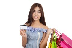 Beautiful Asian woman hold shopping bags show a credit card Stock Photos