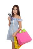 Beautiful Asian woman hold shopping bags show credit cards Stock Photography